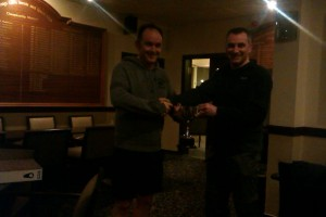 Iain McDermott left receiving the prize from Tim Ross (squash convener)